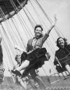 1953. United Kingdom. Leslie Caron on a Carousel (Keystone) - Muzeo.com