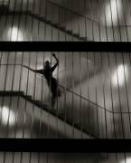 Sensuous Woman Standing on Staircase (Oscar Falk) - Muzeo.com